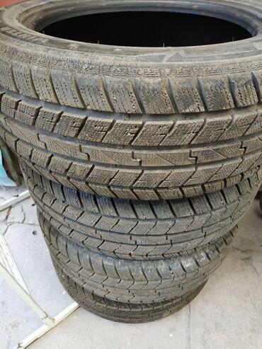 Транспорт - Каракол: Срочно продаю комплект зимней резины205/55/16 почти новая. совсем не