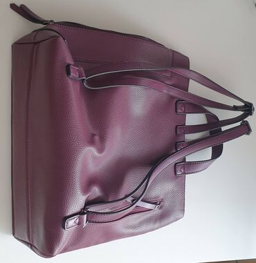Women's Backback in burgundy colour, only worn once! Excellent
