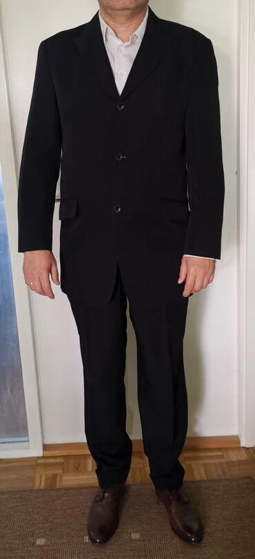 Muška odeća   Beograd: Muško odelo proizvođača CANDA (C&A) crne boje, nošeno, sa