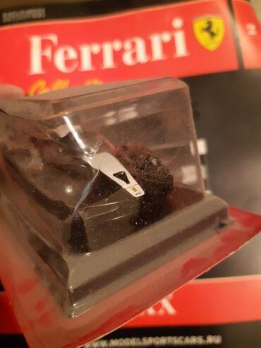 Ferrari modeli jurnal Supercar ilə birliktə. Təzədir. WhatsApp var