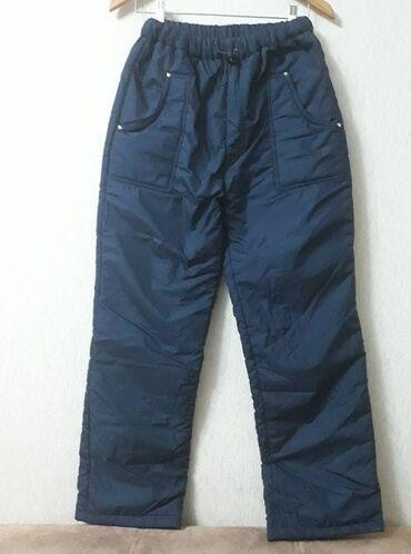 Горнолыжные теплые брюки. Б/у в хорошем состояние. Цвет-темно синий