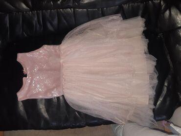 Dečija haljinaveličine 12,obučena jednombez oštećenja