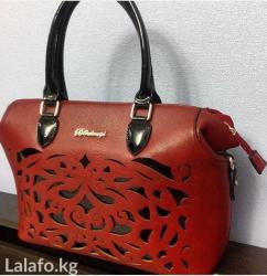 аялзат в Кыргызстан: Кожаная сумка,есть длинный ремешок. Узоры из лака