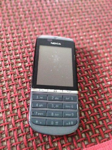 Nokia asha 210 - Srbija: NOKIA ASHA 300 sa original punjacem, radi- jedino nema dugme za gase