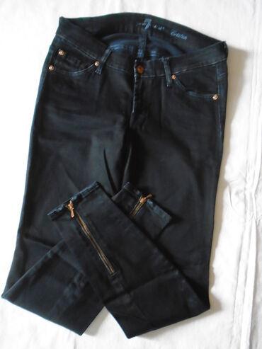 Farmerki pantalone - Srbija: Nove crne pantalone/farmerke sa zipom na nogavici od 98% pamuka i 2%
