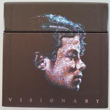 Κασετίνα με 20 singles του Michael Jackson σε dual disc . DVD &