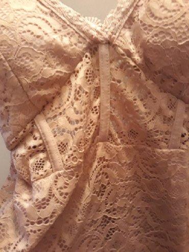 Haljina-cipkasta - Srbija: Roze cipkasta haljinica. Ima providan deo ispod grudi. Haljina sadrzi