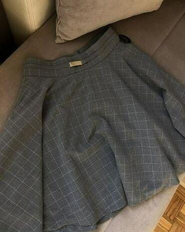 Potpuno nova suknja iz poslovne kolekcije. Na poslednoj slici je