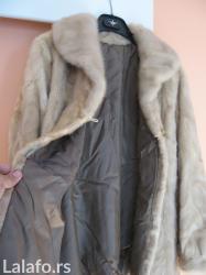 Kratka bunda od nerca, malo nošena, veličina 40 - 42, dužina bunde - Belgrade