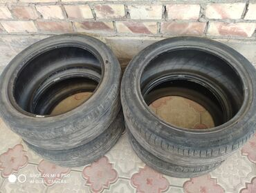 Транспорт - Дмитриевка: Продам комплект летних шин размер 235 /45/18 протектор 60% цена догов