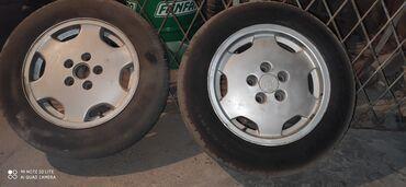 шины 19560 r16 в Кыргызстан: Продаю комплект (5шт)R15 дисков с резиной на Ауди или меняю на R16 или