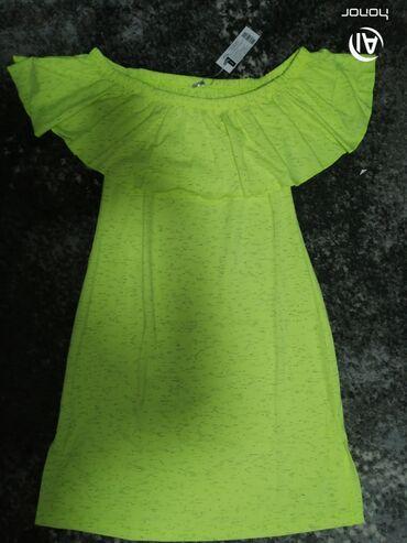 Letnja pamucna haljina zute boje u velicini L,materijal je prosaran sa