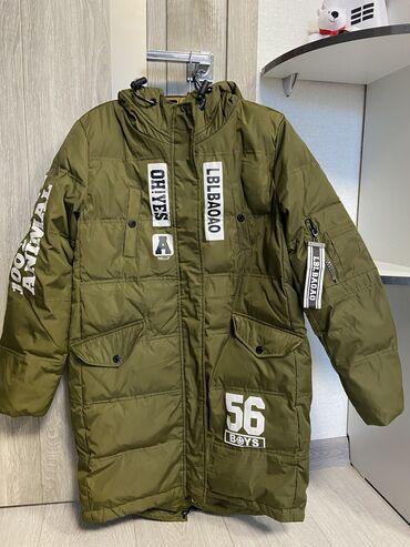 Продаю зимний пуховик, зелёный. в хорошем качестве. продаю куртку