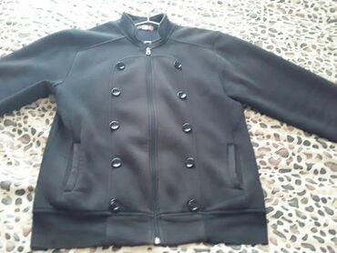 Куртка черного цвета,б/у. 46-48 размер. Есть ещё разная одежда. Чтобы
