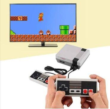 Nintendo Switch - Srbija: 🕹N I N T E N D O KONZOLA🕹  Cena 3100 din  Za sve ljubitelje retro igar
