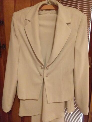 Četvorodelni ženski komplet ( sako, bluza, suknja, pantalone )