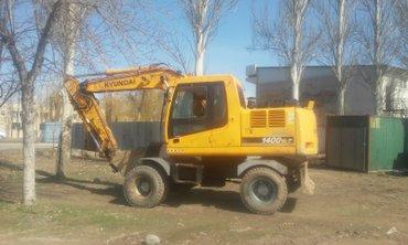 услуги экскаватора  hundai 1400w,  а так же кран - манипулятор, в Бишкек