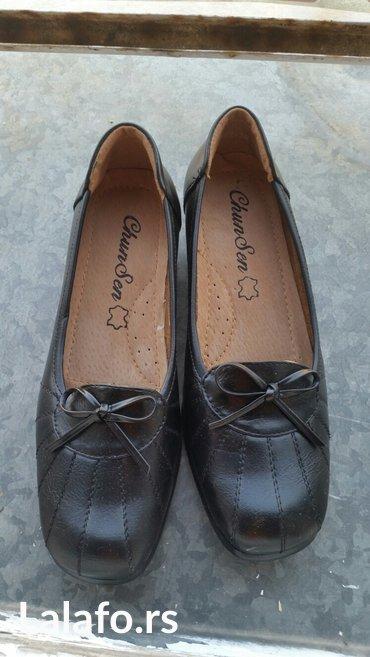 Nove crne cipelice sa malom peticom nikad nosene sto govore slike. - Crvenka