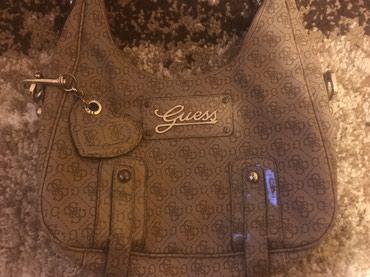 Original Guess torba,odlicno ocuvana,manji znaci nosenja...na slikama - Crvenka