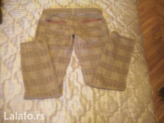 Karirane pantalone Terranova, lepo ocuvane, kroj kao farmerke. - Zrenjanin