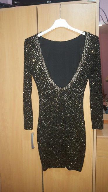 Haljine   Kostolac: Crno zlatna haljina, sa 3/4 rukavima, jako lepo stoji