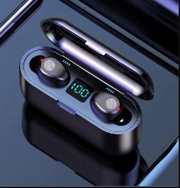 Bluetooth qulaqliq hem telefon tutacagi, hem de powerbank kimi
