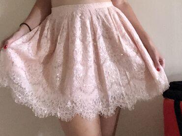 Top Shop čipkasta suknja sa providnim sljokicama u veličini 38. Nikad