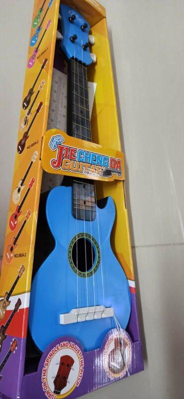 Gitare | Srbija: Gitara igračka za decu raznobojne CENA: 1700 din CENA JE PO KOMADUKod