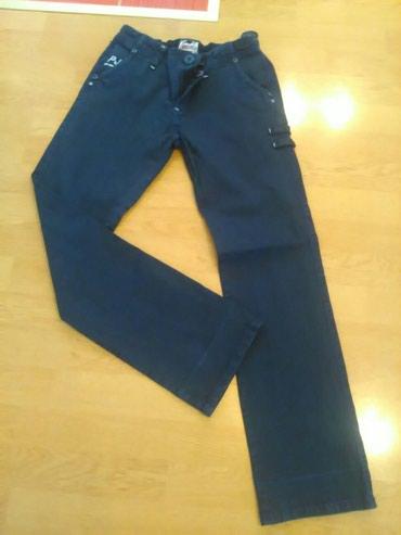 Decije pantalone teget plave.Obucene dva puta kao nove su.Vel.14 - Bajina Basta