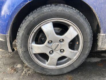 диски на авто r14 в Кыргызстан: Продаю диски с шинами 4х114  R14 155/65 Bridgestone зимние в хорошем с