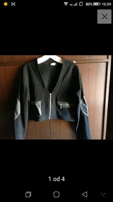 Kratka moderna jaknica sa elastinom,kao nova .......velicina S-M.  - Belgrade