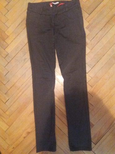 Crne pantalone sa dzepovima - Srbija: SNIZENO. samo 300 din.Zenske pantalone.Dva puta nosene.Dzepovi sa