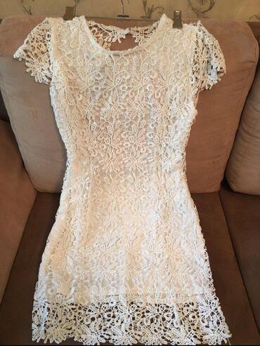 Брендовая платье. очень высокого качества. идеальном состоянии. ЦЕНА