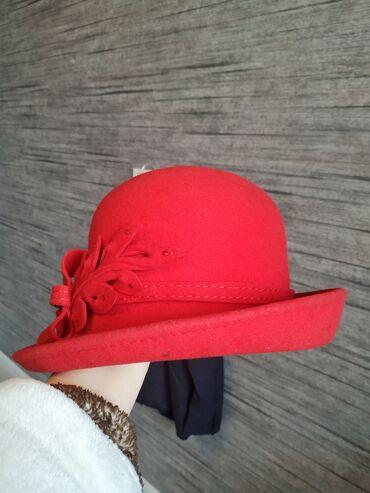Фетровые шляпки от известного производителя головных уборов. Украсят