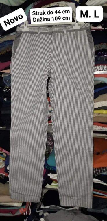 Nove pantalone M. L.  Dimenzije na slici