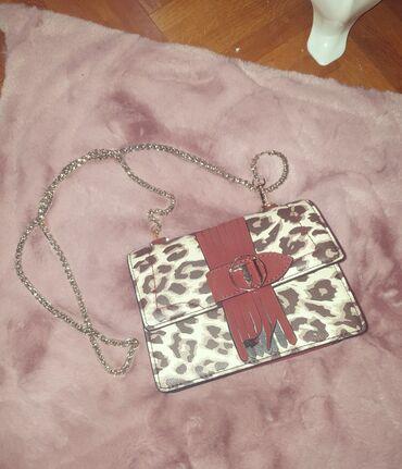 Trusardi kozna torba leopard print  torba je nosena jednom u odlicnom