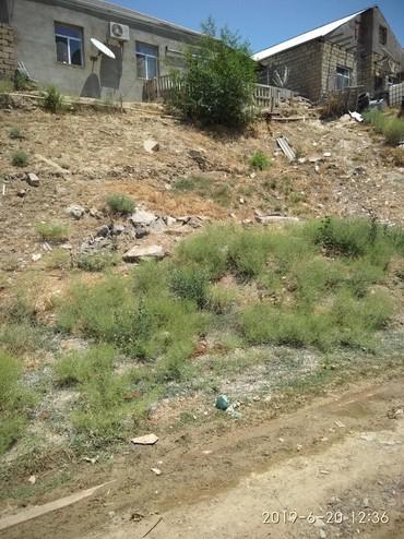 Xırdalan şəhərində Torpag satilir xirdalanda 1 sotdu yollu asfaltdi 4000 manata.nomrede