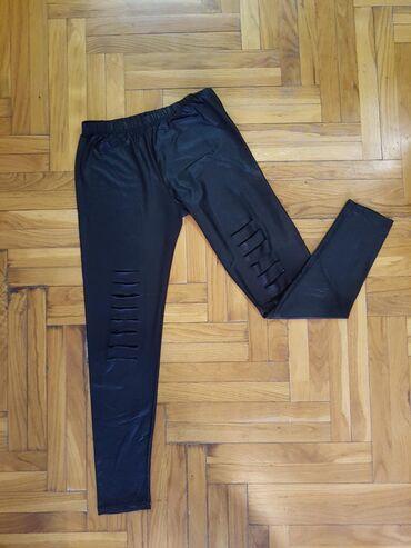 Pantalone-kozne - Srbija: Kozne helanke sa prorezima,nosene ali ocuvane