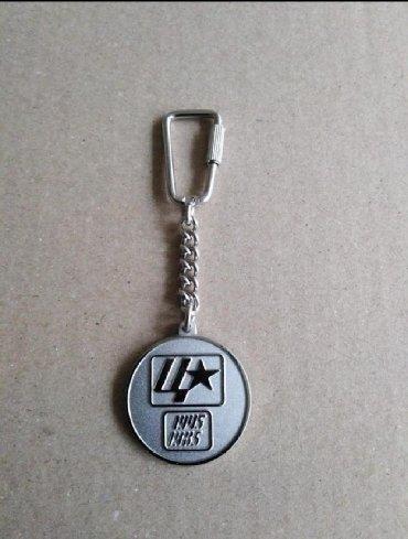 Značke, ordeni i medalje | Srbija: Privezak za ključeve. Stanje je kao na slici. Cena 300din