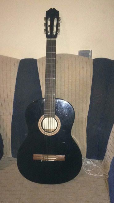 Xırdalan şəhərində Gitara satilir tezedir 90 manata elaqe nom