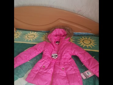 Новый зимний пуховик. на 7-8 лет в Бишкек