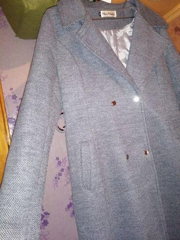 Yeni paltodu cox az istifade edilib Xl razmerdir 90.azne alinib awagi