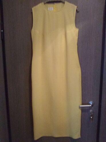 Duga leprsava haljina - Crvenka: Haljina dugačka žuta od punijeg letnjeg žoržeta. Kroj prati liniju