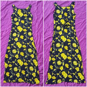 Maxi haljina vel. 36 crne boje sa žutim cvetovima. Ne snira se. Vezuje