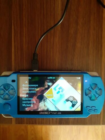 PSP (Sony PlayStation Portable) - Azərbaycan: Oyun konsolu PS3D icinde 20 oyun var. Karopkasi ve adoptoru var (Sual