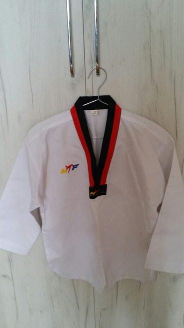 Bakı şəhərində Спортивная форма для мальчиков 8-9 лет по тхэквондо дзюдо или карате
