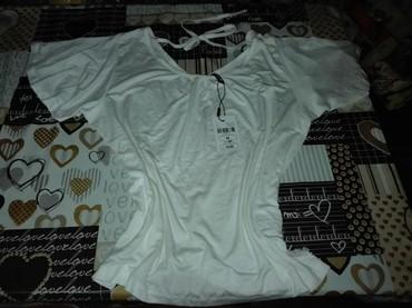 Prodajem majicu - Srbija: Nova original majica bez oštećenjavelicina m moze l prelepog