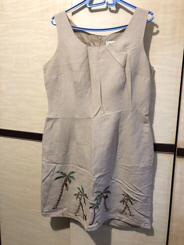 Lanena haljina velicina 42, sa malim znalovima koriscenja. Detalji u i
