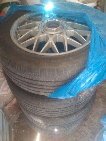 летние шины 21560 r16 в Кыргызстан: Шины R16 с дисками от Субару Комплект Новые шины летние