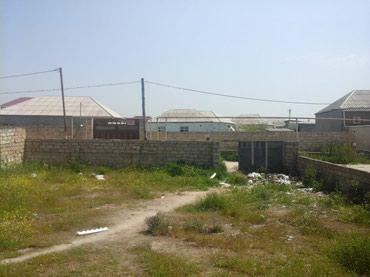 Bakı şəhərində Ramana savxozunda yolda 100 m mesefede ev 4 otaq qosa das 5 sotun